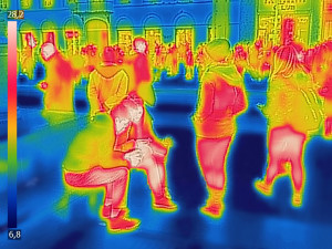 Infrared Thermal image of people at the city railway station, on a cold winter day